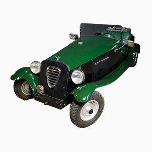 Vintage Motorized Green and Black Model Sportscar