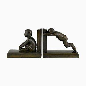 Art Deco Bronze Buchstützen von Boy and Girl Satyr von Paul Silvestre, 1920er, 2er Set