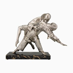 Escultura Art Déco de bailarines cubistas Pierrot y Colombine de Thomas François Cartier, años 30