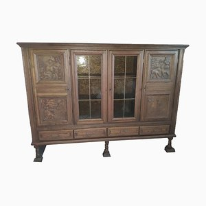 Antique Wooden Display Cabinet with Remarkable Animal Carvings