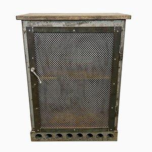 Mobiletto industriale in ferro con anta a rete, anni '60