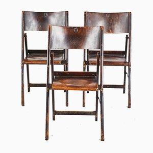 Klappbarer Stuhl aus dunklem Holz
