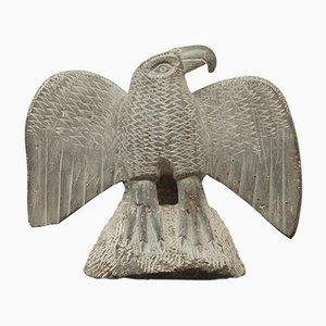 Escultura de águila de piedra, años 50