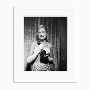 Grace Kelly Clutches Her Oscar Archival Pigment Print Framed in White by Bettmann