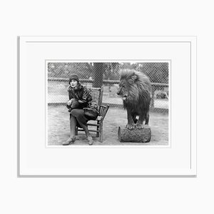 Greta & Leo the Lion At the Park Archival Pigment Print Framed in White by Everett Collection