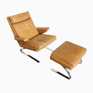 Vintage Swing Leather Lounge Chair & Stool by Reinhold Adolf for Cor, Set of 2