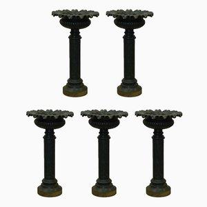 Pilares florales antiguos de hierro fundido. Juego de 5