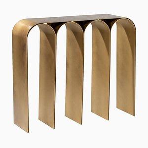 Consolle ad arco in ottone dorato di Pietro Franceschini