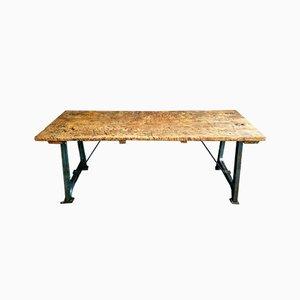 Tavolo industriale in faggio con gambe in ghisa, anni '70