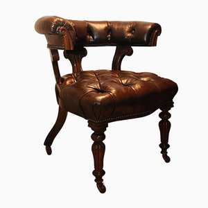 Antique Brown Leather & Mahogany Button Back Library Chair with Carved Frame & Fluted Brass Castor Legs