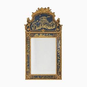 Espejo estilo Regency de madera bañada en oro y lacado en azul, años 80