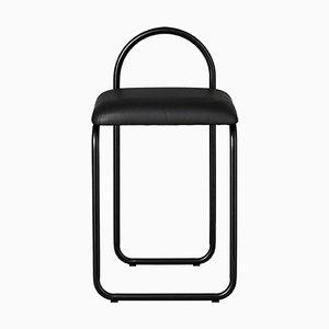 Silla de comedor minimalista de cuero negro