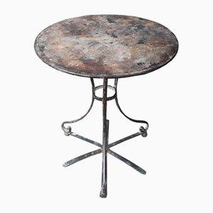 Mesa de jardín antigua con pedestal