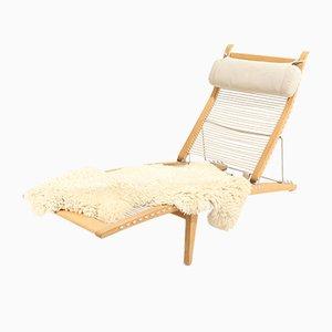 Sedia a sdraio modello PP-524 con cuscino in pelle di pecora di Hans J. Wegner per PP Møbler, Danimarca, 2005