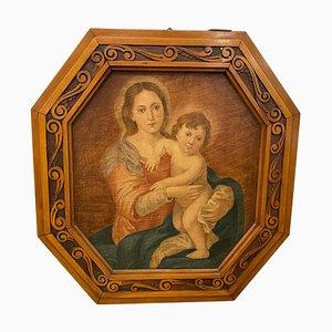 Óleo sobre lienzo Art Nouveau, en octogonal, que representa a una Virgen con un niño Jesús