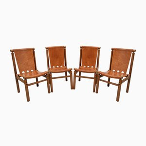 Italian Leather Dining Chairs by Ilmari Tapiovaara for La Permanente Mobili Cantù, 1950s, Set of 4