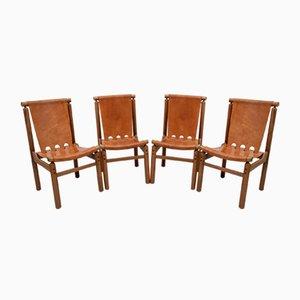 Italienische Leder Esszimmerstühle von Ilmari Tapiovaara für La Permanente Mobili Cantù, 1950er, Set of 4