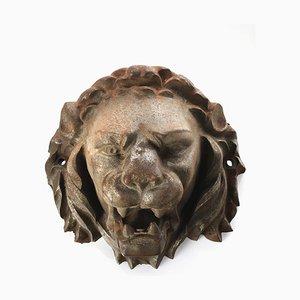 Cabeza de león de hierro fundido