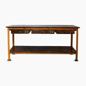 Aparador o mesa de trabajo industrial vintage con 3 cajones