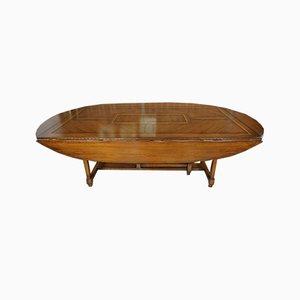 Mesa de comedor vintage de madera con incrustaciones