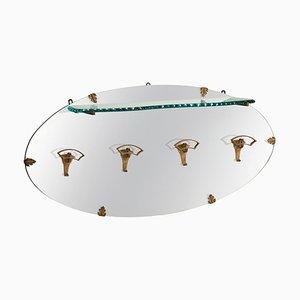Perchero de hierro dorado con estante de vidrio y espejo ovalado de Pier Luigi Colli, Italy, años 50
