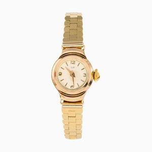 Reloj para señoras de labios en dorado, años 60
