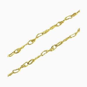 Goldene Halskette mit Zeichenmotiven