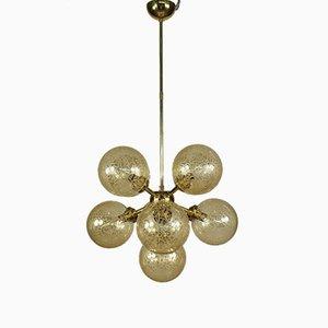 Lámpara de araña Sputnik Mid-Century de latón y vidrio ámbar