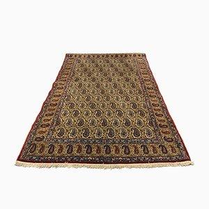 Handgeknüpfter orientalischer Vintage Teppich in Rot, Beige und Blau aus Wolle