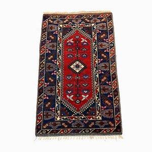 Alfombra Tribal turca vintage mediana en rojo, azul marino y lana beige