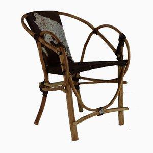 Butacas hechas a mano con asientos y respaldo de piel de vaca. Juego de 4