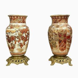 Jarrones de porcelana y bronce dorado. Juego de 2
