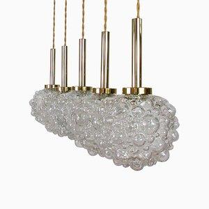 Lámpara colgante alemana Mid-Century de latón y burbuja transparente, años 60