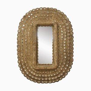 Specchio ovale in legno intagliato