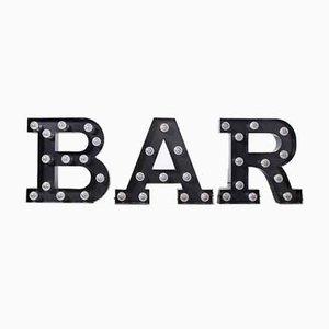 Black Luminous Letters, Bar