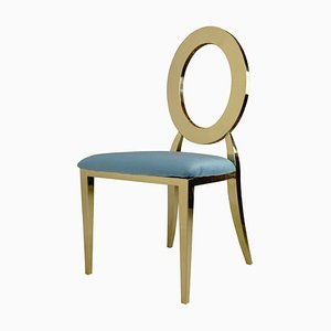 Sedia in velluto color oro e turchese