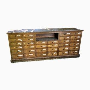 Banco da farmacia vintage con 32 cassetti e vetrine