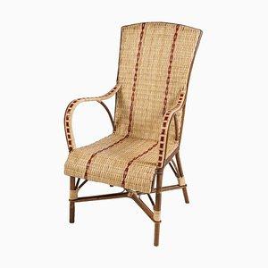 Geflochtener Armlehnstuhl aus Rattan mit rotem Rand