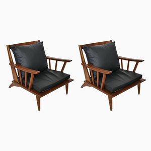 Juego de sillones de cuero y teca, años 60. Juego de 2