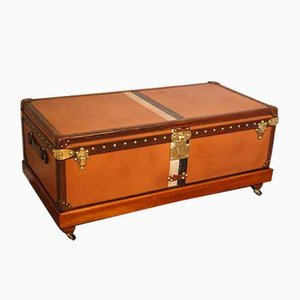 Baúl de viaje naranja de Louis Vuitton