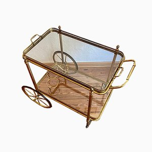 Neoclassical Golden Brass Bar Cart with Two Tops in Glass & Rubber-Tired Wheels