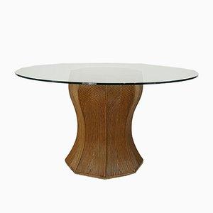 Mesa de comedor italiana vintage redonda de vidrio y ratán con pedestal, años 70