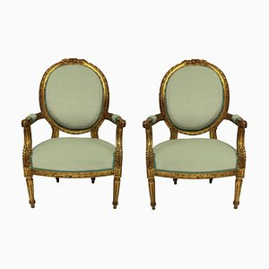 Vintage Armlehnstühle im Louis XVI Stil aus vergoldetem Holz, 2er Set