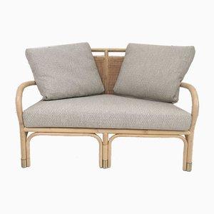 Rattan, Cane & Brass Armchair