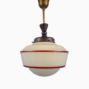 Lámpara colgante de vidrio opalino con franja roja, años 30