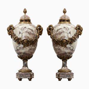 A.Cadoux, mármol Poutiche y bronce dorado. Juego de 2