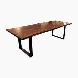 Tisch aus Nussholz und schwarzem Metallrahmen