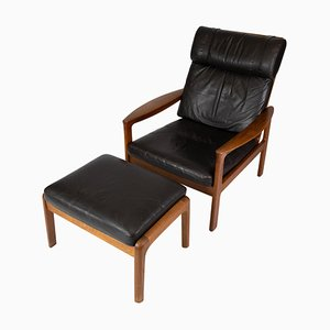 Easy Chair with Stool in Teak Upholstered with Black Leather by Arne Vodder for Komfort, Set of 2
