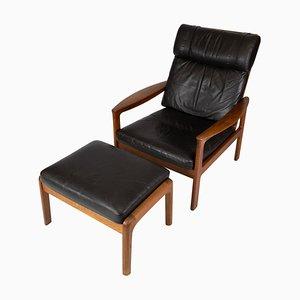 Poltrona con taburete de teca tapizada en cuero negro de Arne Vodder para Komfort. Juego de 2