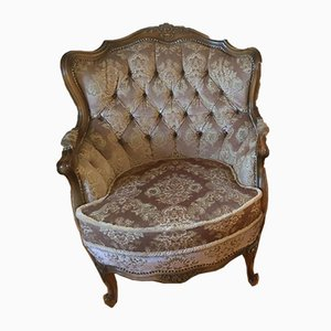 Antique Upholstered Armchair with Floral Pattern